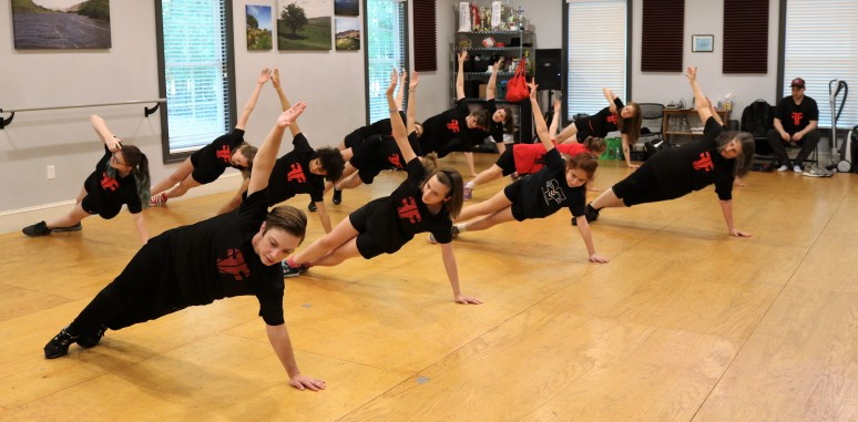 Dancers exercising with Fusion Fighter